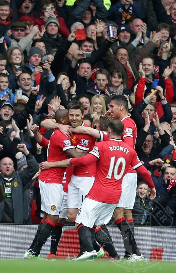 Michael Carrick of Manchester United celebrates scoring their second goal during the Barclays Premier League match between Manchester United and Tottenham Hotspur at Old Trafford on March 15, 2015 in Manchester, England.