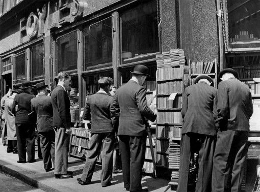 City gents browsing Foyles' outside stock then...