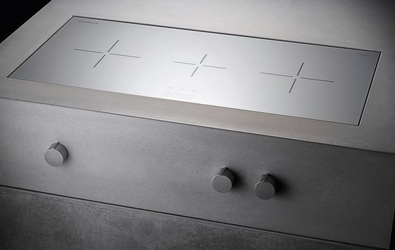 Heart of Gold is a new edition of the stunning concrete kitchen line we featured in one of our previous posts. Designed by Martin Steininger and Michael Paar, Heart of Gold adheres to the same minimalist principles as its predecessor. The seamless look is reinforced by several new elements – hidden water outlet in the sink, magnetic drawer partitions, ceramic hobs visible or hidden by an automatic panel.