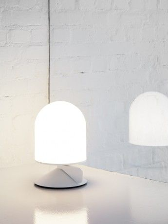 "Vinge | Note Design Studio | ""domed table lamp that is dimmed by rotating a wing at its base up to 180 degrees around it's central axis."""