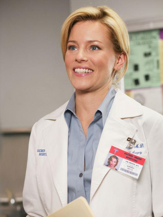 Dr. Kim Briggs (Elizabeth Banks)