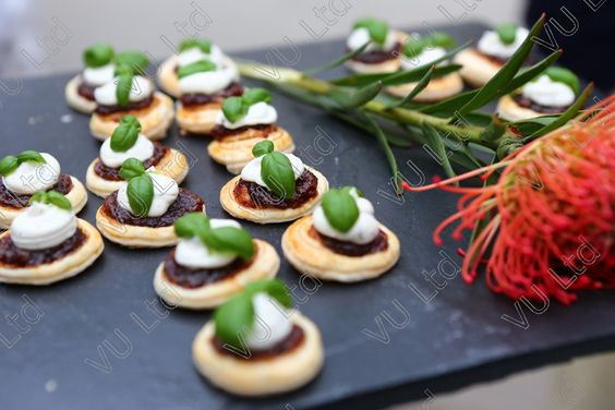 Caramelised red onion and Goats cheese puff tart garnished with micro basil   Vege canapé
