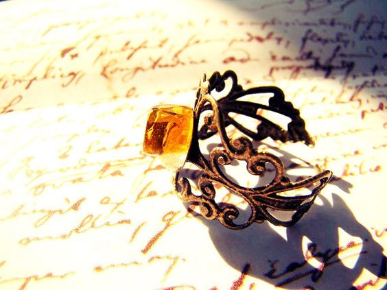 antic ring with golden amber by anaartshop on Etsy, €3.00