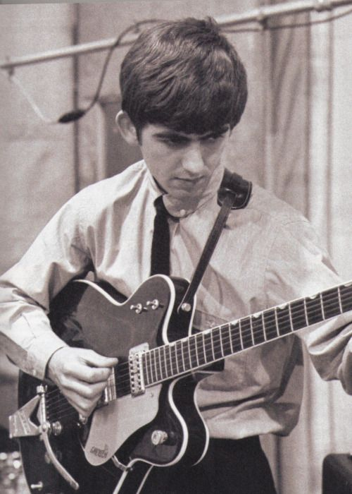 "George Harrison tuning his Gretsch Country Gentleman at the ""She Loves You"" recording session, EMI Studios, Abbey Road, London, 1 July 1963. Scanned from Guitar World. Photo: Terry O'Neill ""The [ending of 'She Loves You'] 6th chord idea was George's - George Harrison's."" - Paul McCartney on 'She Loves You' and its distinctive ending chord, The Beatles Anthology"