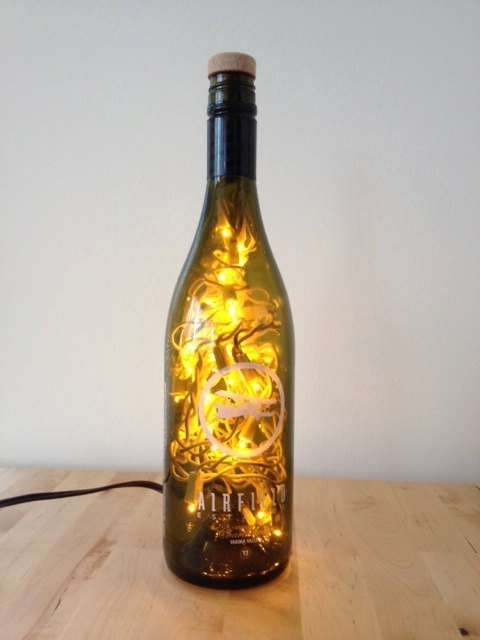Winter holidays wine bottles and bottle on pinterest for Empty wine bottle decoration ideas