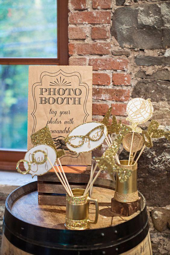 glittery gold photobooth props, photo by Izzy Hudgins http://ruffledblog.com/glitzy-bohemian-ny-wedding #wedding #reception #photoboothprops