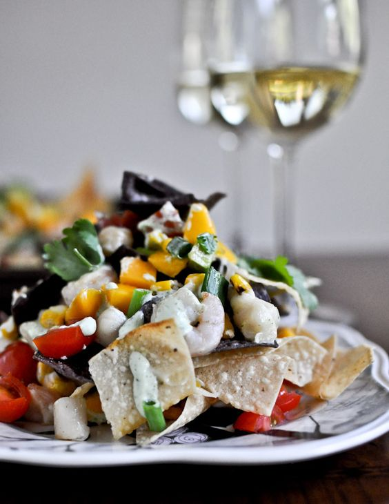Summertime Seafood Nachos with Grilled Corn + Avocado Cream. | http://pinterest.com/pin/269441990177039367/