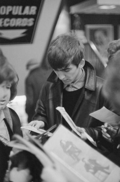 George Harrison with fans