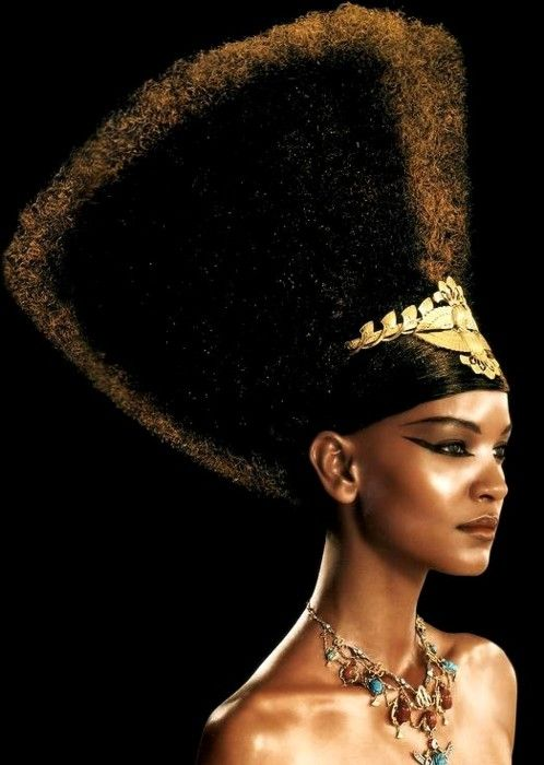 Contemporary Egyptian Princess on the runway with the iconic head- and neckpieces.