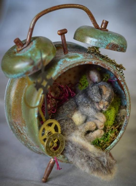 Made to order Baby Life like Squirrel -OOAK ( One of a Kind ) Needle Felt Lost Time Squirrel measures 4 L curled up more gray than brown Old Style Patina Alarm clock nest taking warm afternoon break. Her nest is made moss with hints of tiny green leaves. The back round is of paper with red