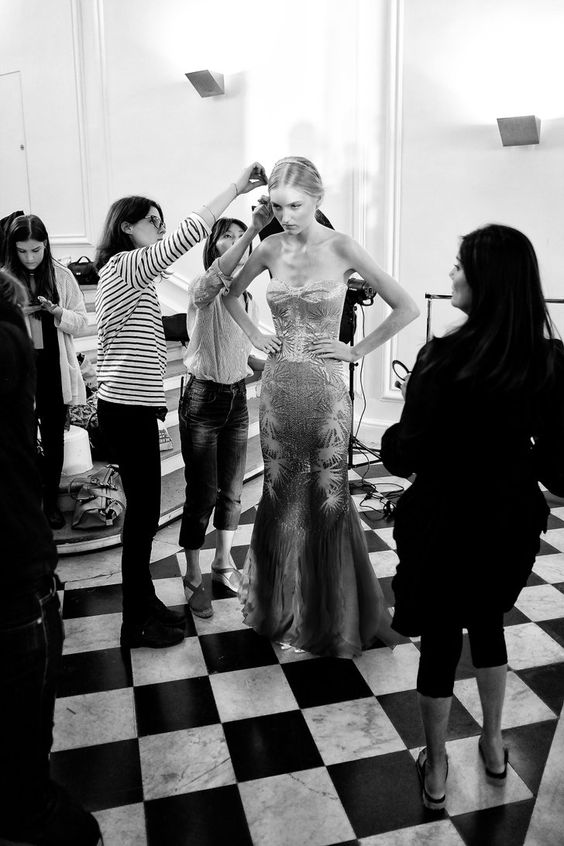 Pin for Later: If You Thought Catwalk Couture Looked Amazing, Wait Until You Go Backstage  Last touches are put to a look backstage at Rami Al Ali.