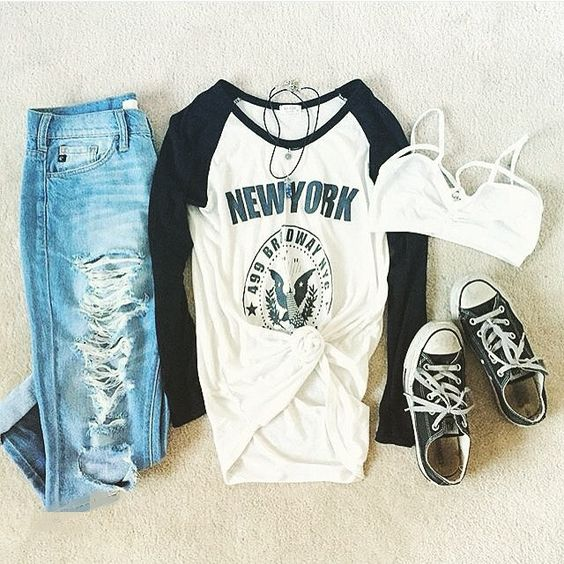 Grunge outfit idea nº12: Blue sleeve Varsity T, navy Chuck Taylors, and shredded blue jeans - http://ninjacosmico.com/23-awesome-grunge-outfits/:
