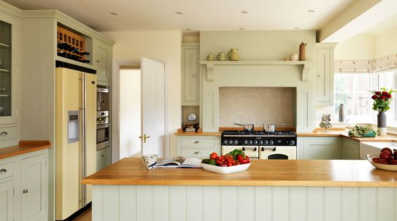 Rangemaster Classic range cooker with an American-style fridge freezer in traditional cream.