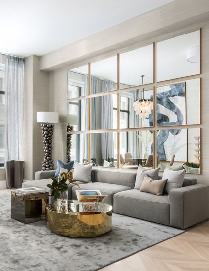 Popular Living Room Wall Decor | Mirror Wall | Contemporary Living Room by IMG NYC; photography by Evan Joseph Photography | Find more inspiration in the LuxDeco.com Style Guide