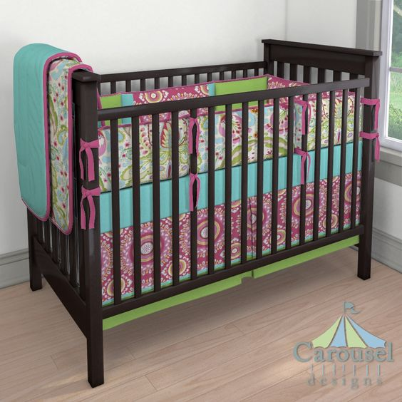 Crib bedding in Solid Teal, Kumari Garden Jeevan, Solid Lime, Kumari Garden Teja, Solid Fuchsia. Created using the Nursery Designer® by Carousel Designs where you mix and match from hundreds of fabrics to create your own unique baby bedding. #carouseldesigns