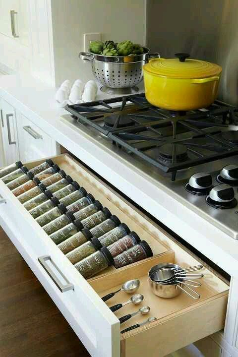 A spice drawer under the stove top keeps things conveniently organized, and makes it easy to find what you're looking for! Find your dream home at http://www.dongardner.com