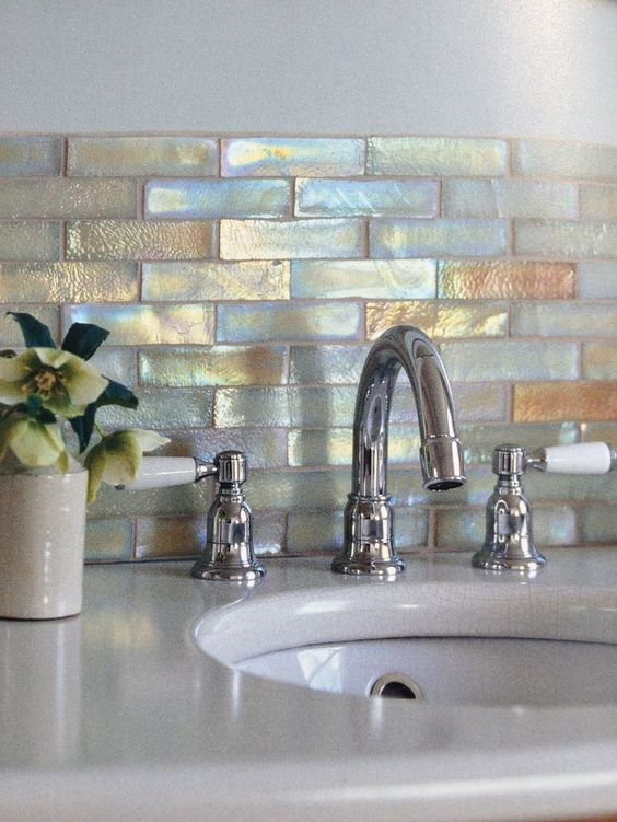 Fired earth mosaic tiles had a stylish pearlescent touch for Backsplash ideas for bathroom sinks