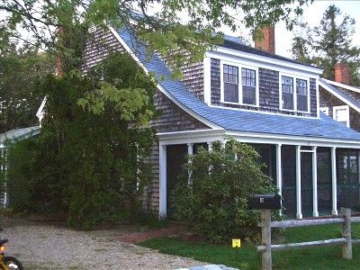 Cape cod with shed dormer like the cedar shake siding for Cape cod dormer addition
