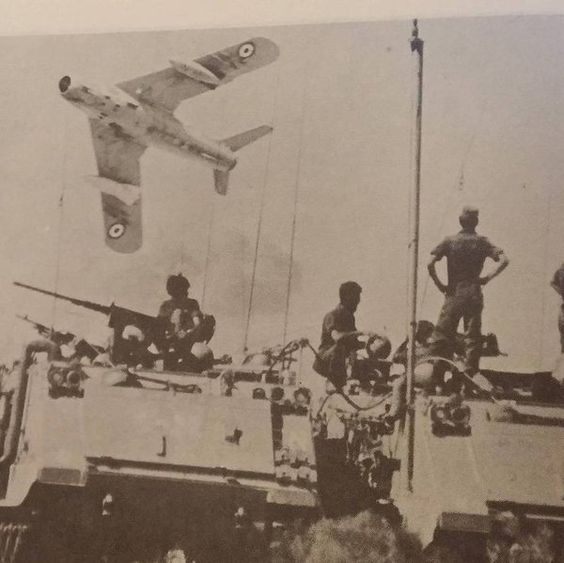 Egyptian aircraft flying over an Israeli tank in the Yom Kippur war 1973. A rare picture taken by.