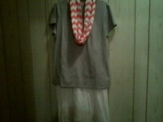 White skirt with lace at the bottom, gray shirt( I would wear a white tank top or black shirt underneath) and an Orange and White Chevron scarf! This would be great for a Vols game day!