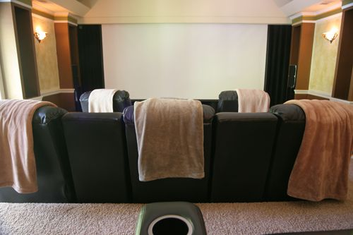 Projector screen in front of flat panel tv.