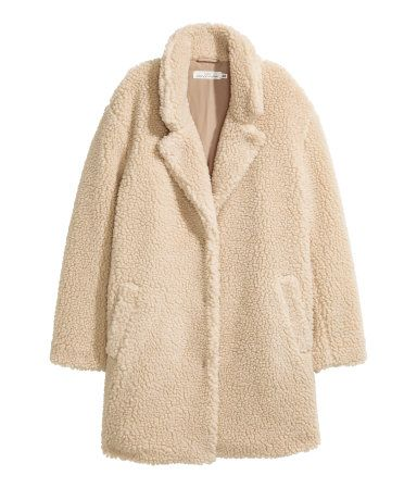 Beige. Short coat in soft pile with notched lapels, concealed snap fasteners at front, and side pockets. Lined.
