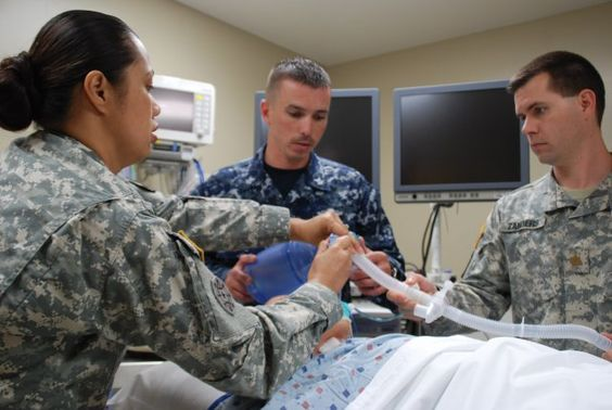 Staff Sgt. Easter Jackson, clinical instructor, explains the functions of a transport ventilator to Navy Petty Officer 2nd Class Justin Speight, an Interservice Respiratory Therapy Program student, as Maj. Thomas Zanders, the program's medical director, looks on in the Pulmonary Department at San Antonio Military Medical Center, May 23, 2012. (Photo by Elaine Sanchez)