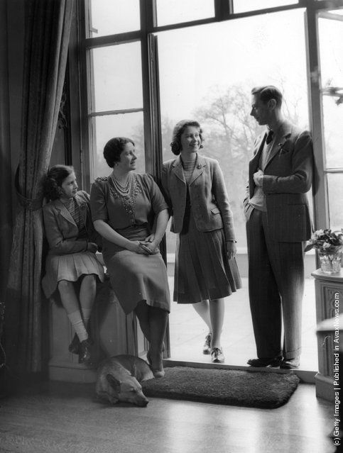 'Just us four'  King George VI relaxes with his wife, the Queen Consort Elizabeth, and his children, Princesses Elizabeth and Margaret at the Royal Lodge, Windsor. 11th April 1942