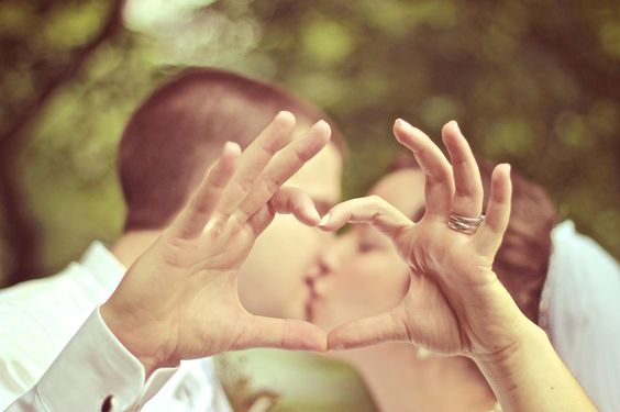 One of my favorite pictures.  We had an engagement picture like this with him kissing my forehead.