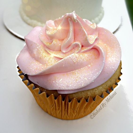 Pink and gold glitter cupcake  So pretty  Edible glitter cupcake. Pink and gold party. Disco dust.   https://www.facebook.com/BakedByMelanii