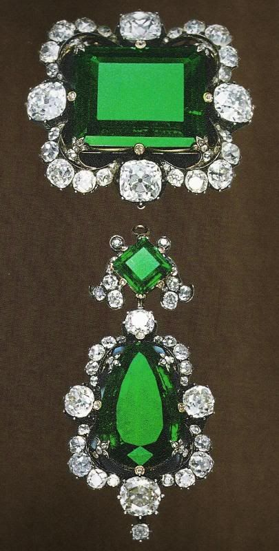 the rectangular stone alone (one on top) is a 42 carat emerald