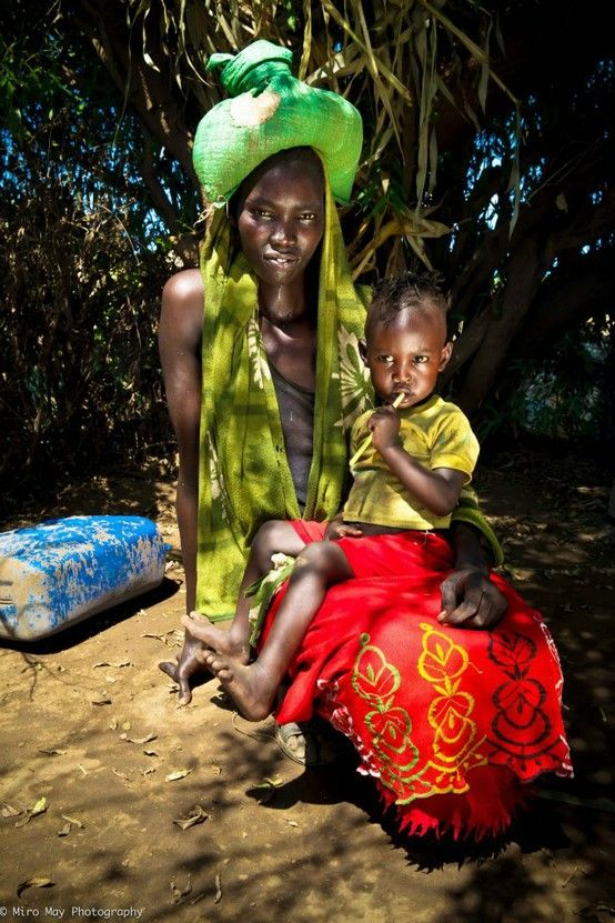 Africa | Portrait of a mother and child Nyangatom tribe, Ethiopia