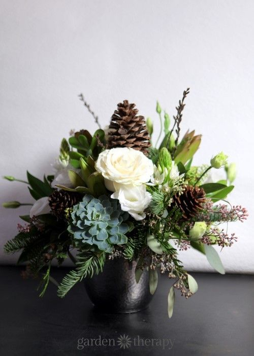 Winter Flower Arrangement with Succulents Roses and Pine Cones:
