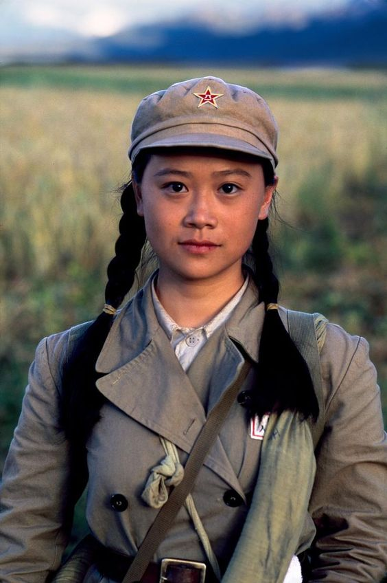 girl in China, with red star cap, photo by Steve McCurry