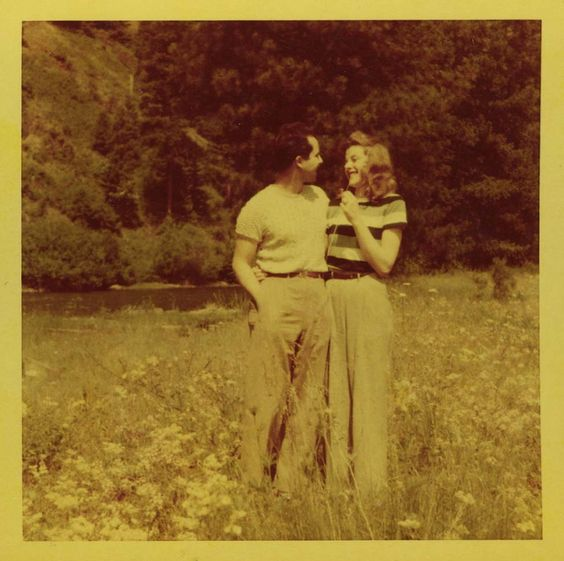 Vintage Photo of a 1950s couple in the forest by a stream. See more vintage photos of couples in love at www.vintageinn.ca blog #1950s #love #valentinesday #vintagephotography #1950sfashion #couples