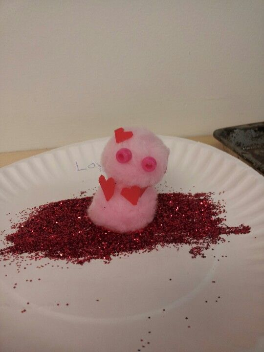 My dughter made this for Valentines day.To make it you need 2 pompom balls two beeds 5 small foam  harts and one big fome hart.enjoy