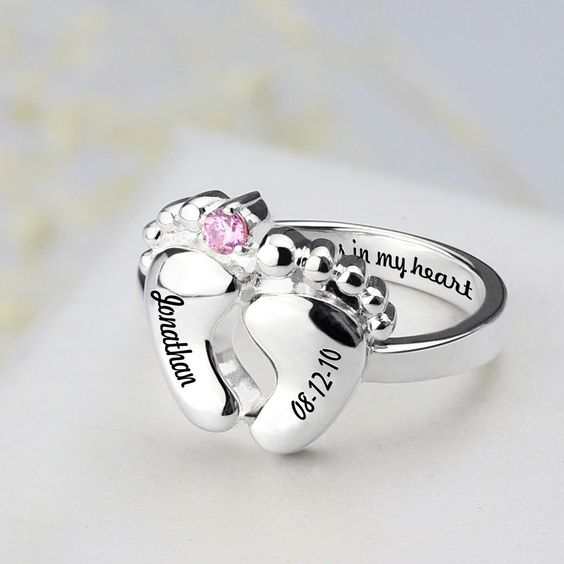 Personalized baby feet rings, the perfect silver rings to celebrate the family milestones in your lives.We carefully apply name and date of your choice to either side of the baby feet to create these beautiful, highly personal, celebration rings.