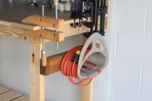 Hose holder for the extension cord