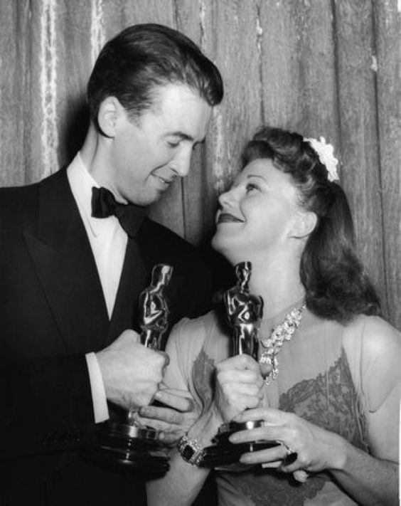 """1941: Actors James Stewart (1908 - 1997) and Ginger Rogers (1911 - 1995) at the Academy Awards banquet, Los Angeles. Stewart won Best Actor in a Leading Role for his performance in """"The Philadelphia Story"""" while Rogers won Best Actress in a Leading Role for her performance in """"Kitty Foyle: The Natural History of a Woman."""" Photo: Getty Images:"""