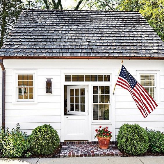 Charming potting shed with Dutch door & side window balanced with lantern - Architect Catherine Sloan: