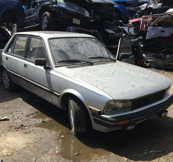 The seller of this rare 1985 Peugeot 505 Turbo sedan uses a rather dramatic backdrop to get his point across – the soon-to-be-carcasses of piles of junk vehicles that tower over this French sport saloon. But... more»