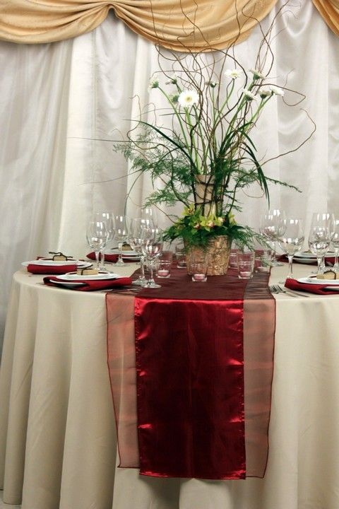Layering organza sashes underneath a satin table runner brings texture and depth to your tablescape in a beautiful and elegant fashion.