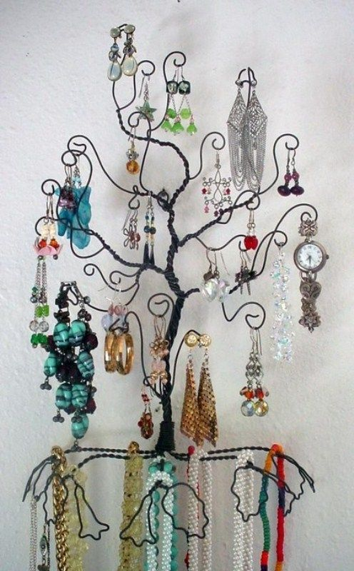 A jewelery tree made from wire coat hangars Jewellery