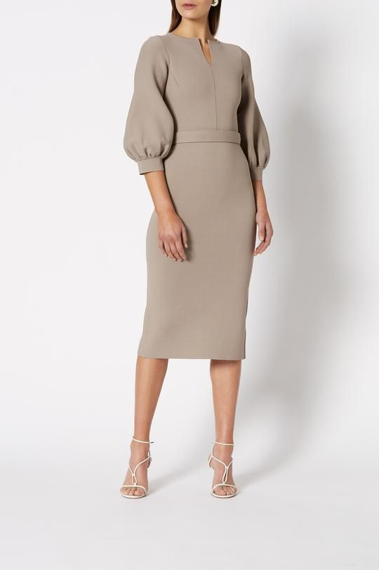 Description Crepe Knit Cocoon Sleeve Dress is a tailored dress which features a v neck, cocoon sleeves, waist belt and pencil skirt to below the knee. Separate belt in same fabric is included. Fabric made in Italy 68% Viscose, 32% Polyamide Clay color Hand wash in lukewarm water and dry flat. Garments should be stored