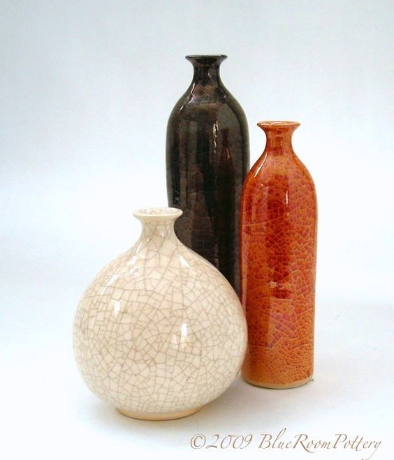 3 Ceramic Bottles, Rustic Home Decor Orange White Black Ceramic Vase Autumn Modern minimalist handmade pottery. $116.00, via Etsy.
