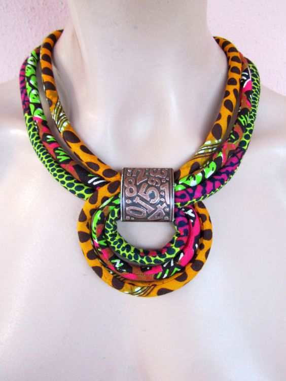 This multi color african fabric necklace is made by me using african wax fabric that I have sewn into tubes and I matched this necklace with a plastic