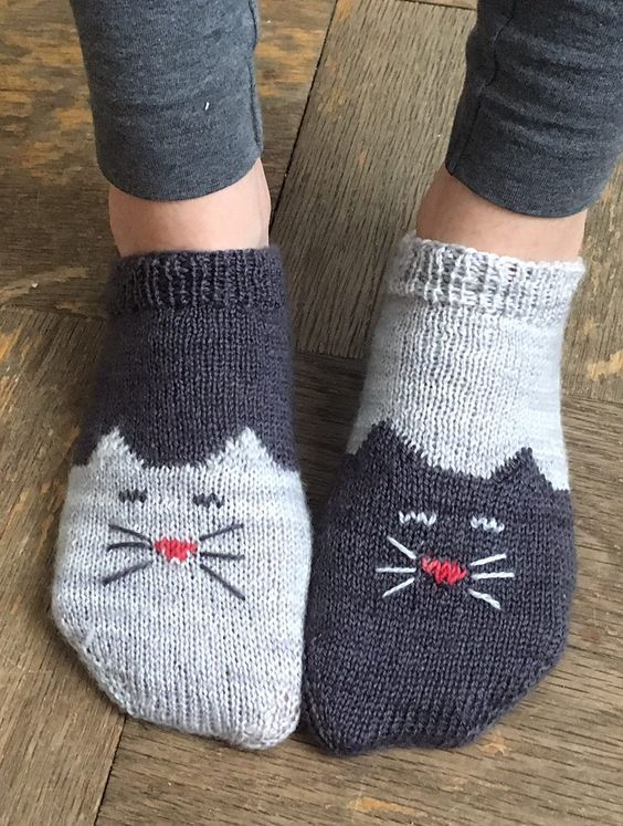 Free Knitting Pattern for Yinyang Kitty Socks - Toe-up ankle socks with a kitty chart on the toe and foot and a simple short-row heel. Designed by Geena Garcia: