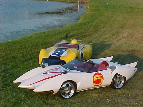 Speed Racer's Mach 5 and behind it is the only known full-size Racer-X car in the world,  The Shooting Star.