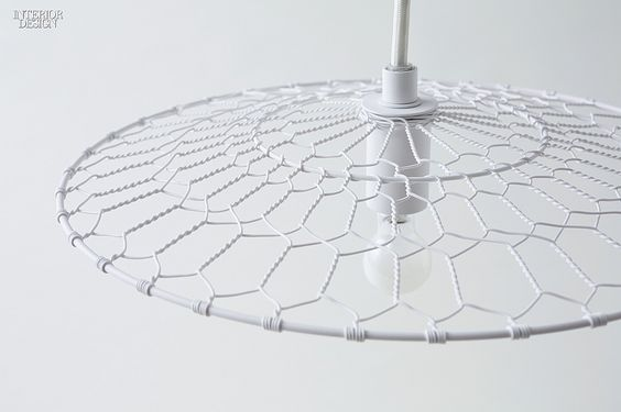 Editors' Picks: 90 Statement Light Fixtures | Basket lamp in powdercoated wire by Nendo. #design #interiordesign #interiordesignmagazine #lighting