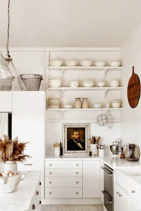 White kitchens design ideas in photos we can't stop pinning! White kitchen with farmhouse style, open shelves, white dishes, rustic decor, and charming cottage style by Kara Rosenlund. #whitekitchen #farmhousekitchen #cottagekitchen #openshelves #allwhite